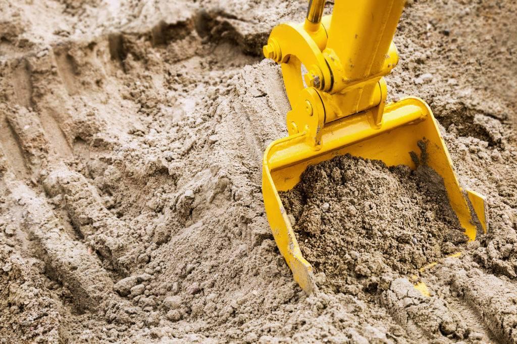 excavator digging sand