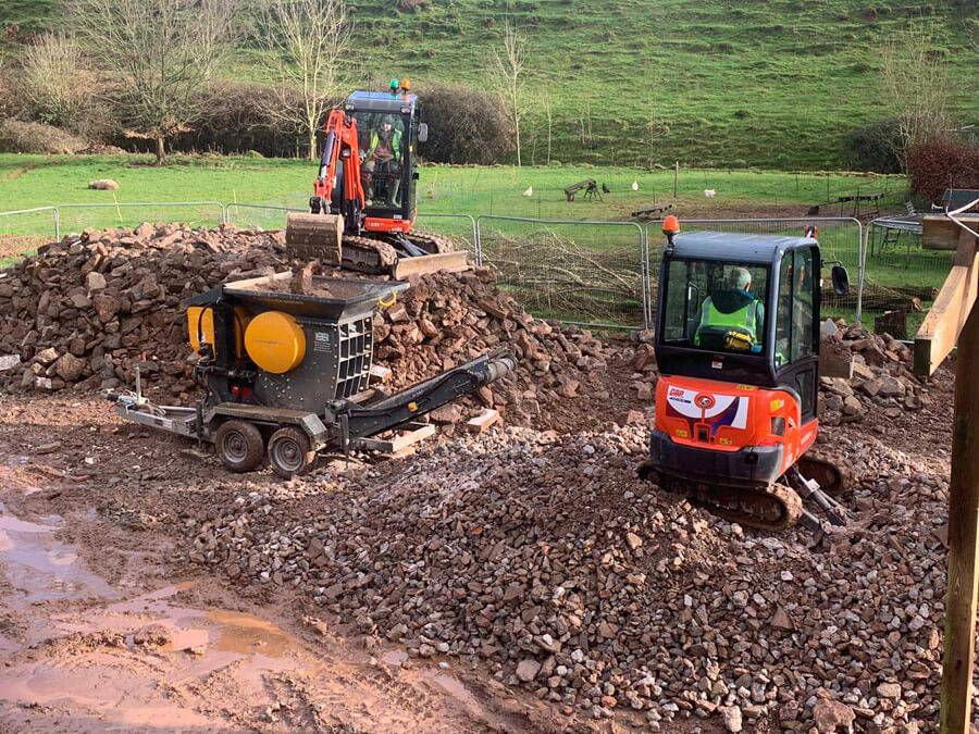 diggers working on building site